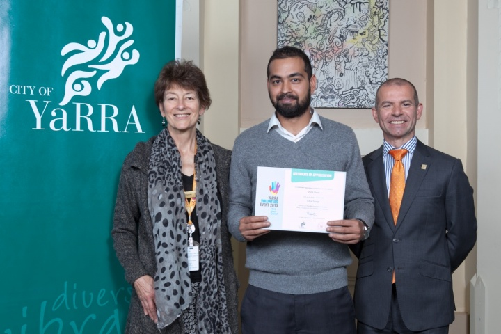 Cr Jackie Fristacky and Mayor Cr Phillip Vlahogiannis present volunteer Malik Umer with a certificate.