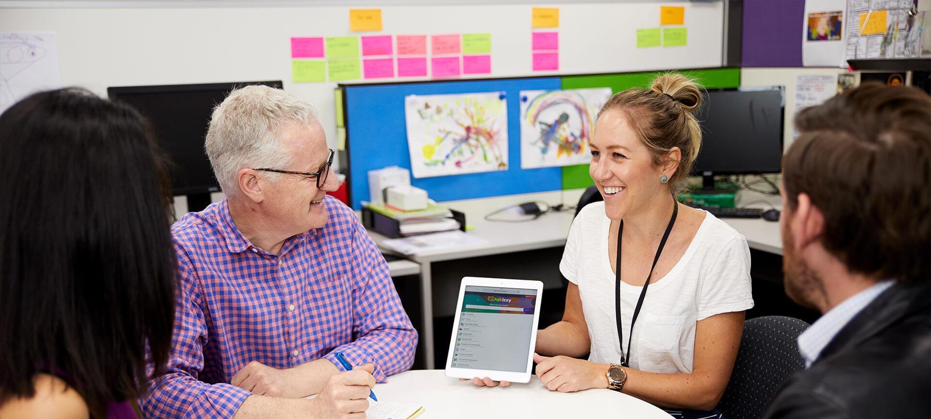 Infoxchange staff sitting around a table