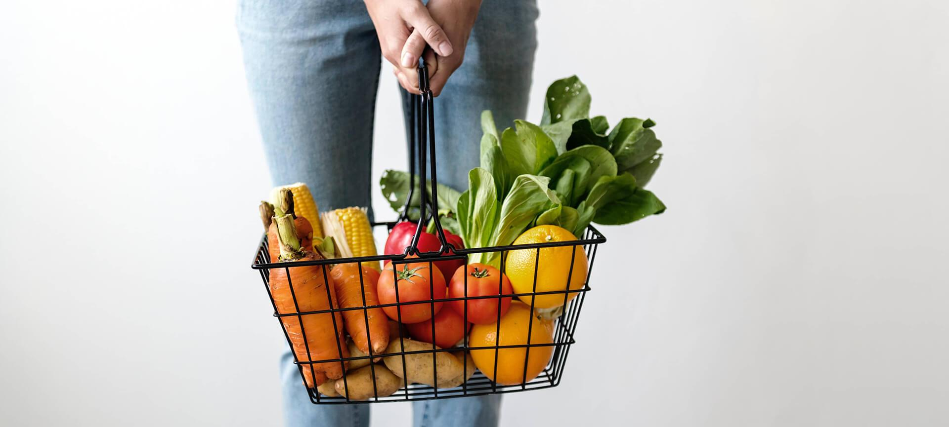 Woman holding basket of groceries