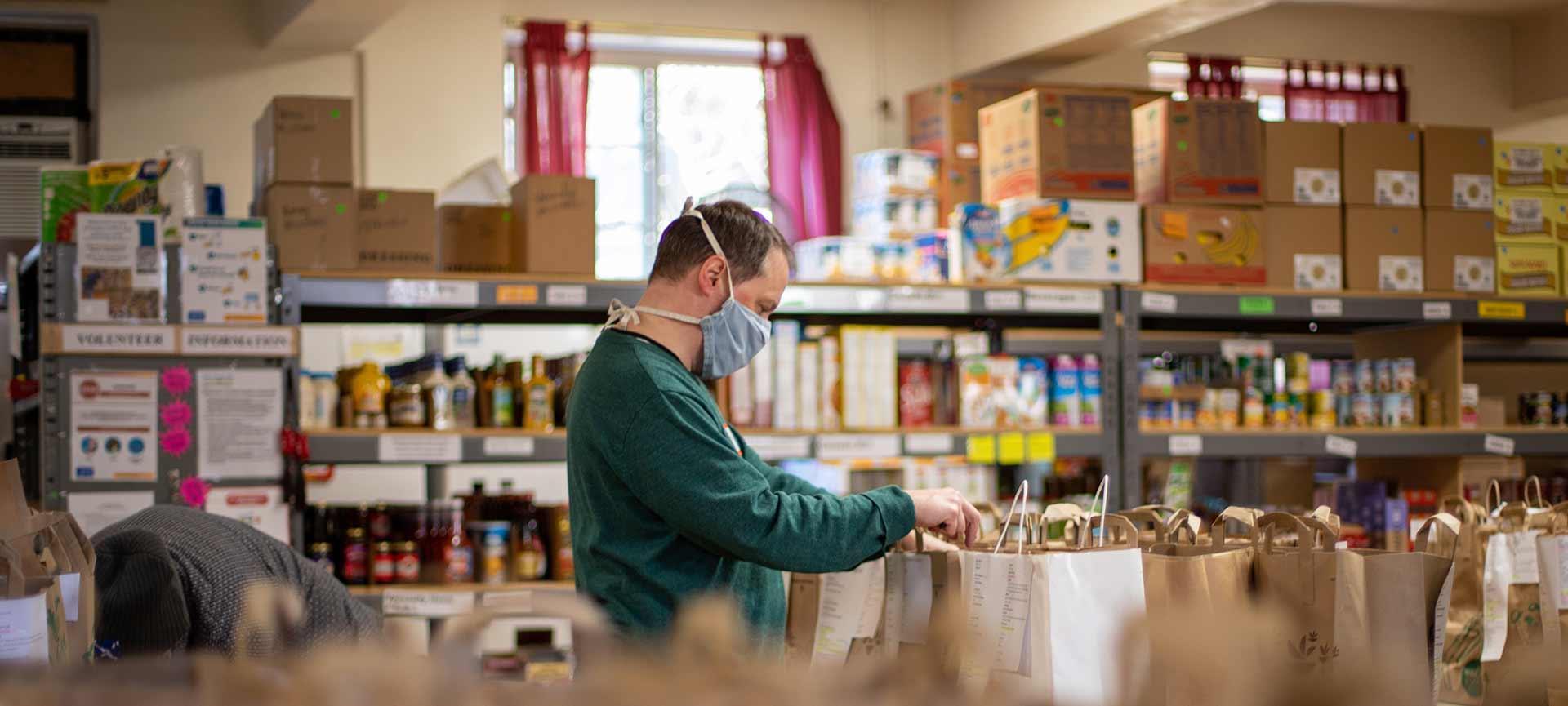 Man volunteering at food bank