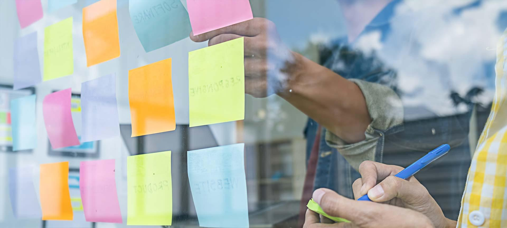 People using post-it notes during a design session