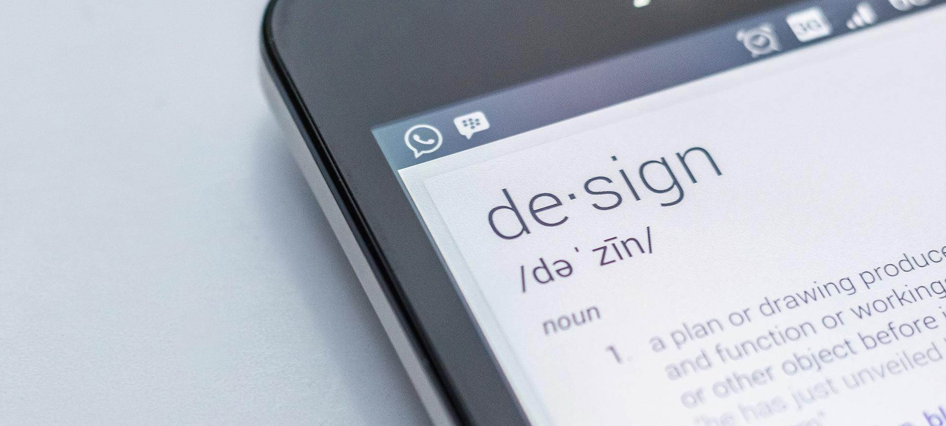 """Smart phone with definition of """"design"""" on display"""