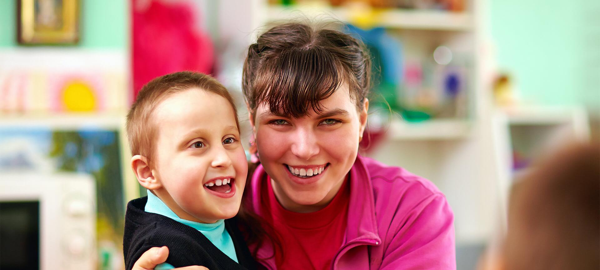 Boy with disability and girl smiling