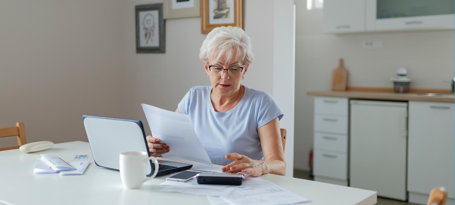 Woman using computer to check her finances