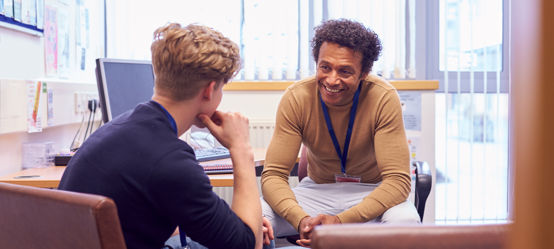 School counsellor speaking to student in an office
