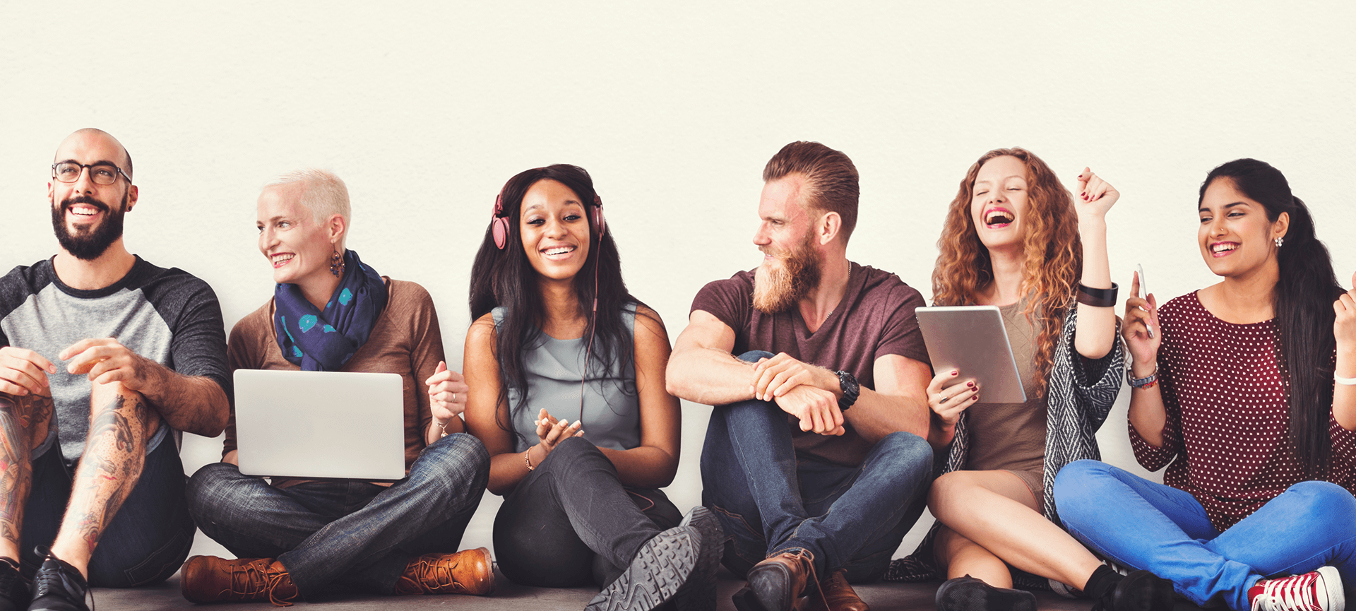 Group of people sitting using technology