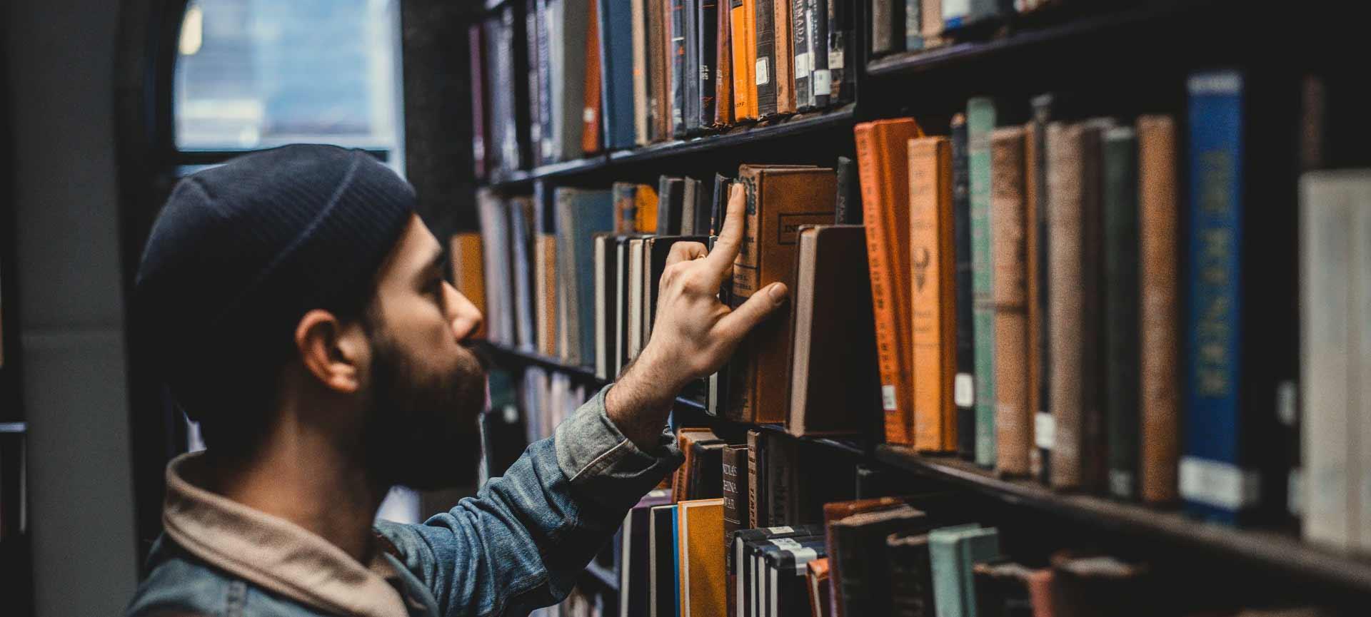 Man selecting book at the library