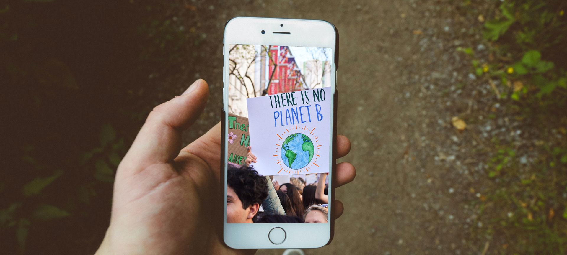 Mobile showing photo of a climate change rally