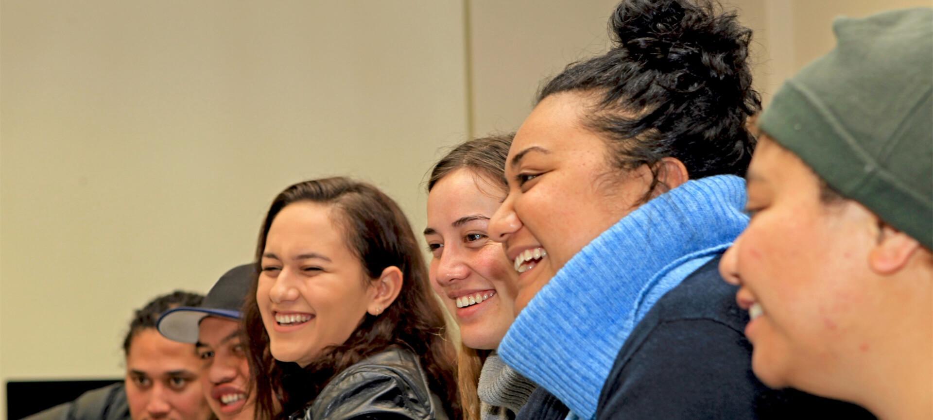 Young Maori people smiling