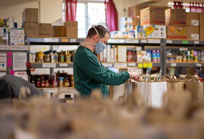 Man packing food at a food bank