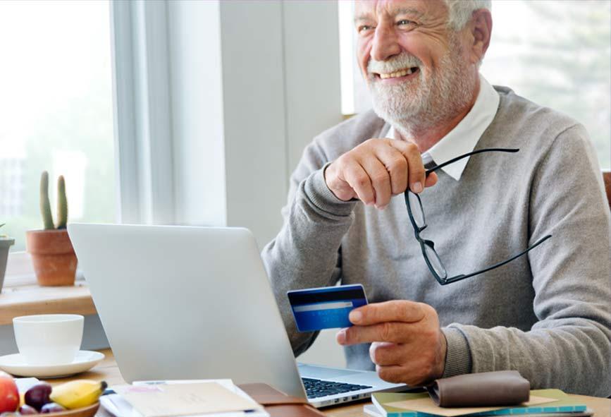 Older man using credit card for online shopping