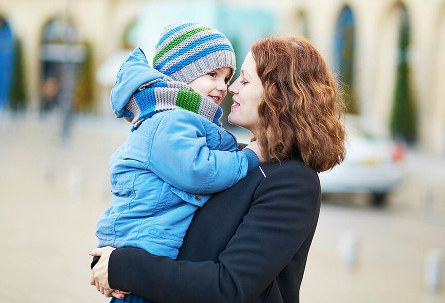 Woman holding small boy