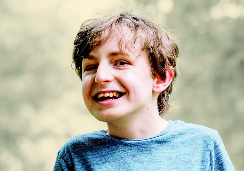 Smiling boy with disabilities