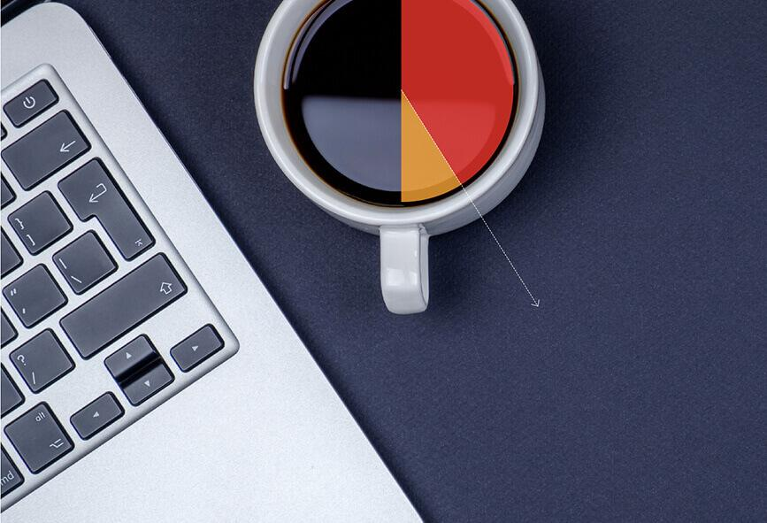 Laptop and mug with graph superimposed over the top