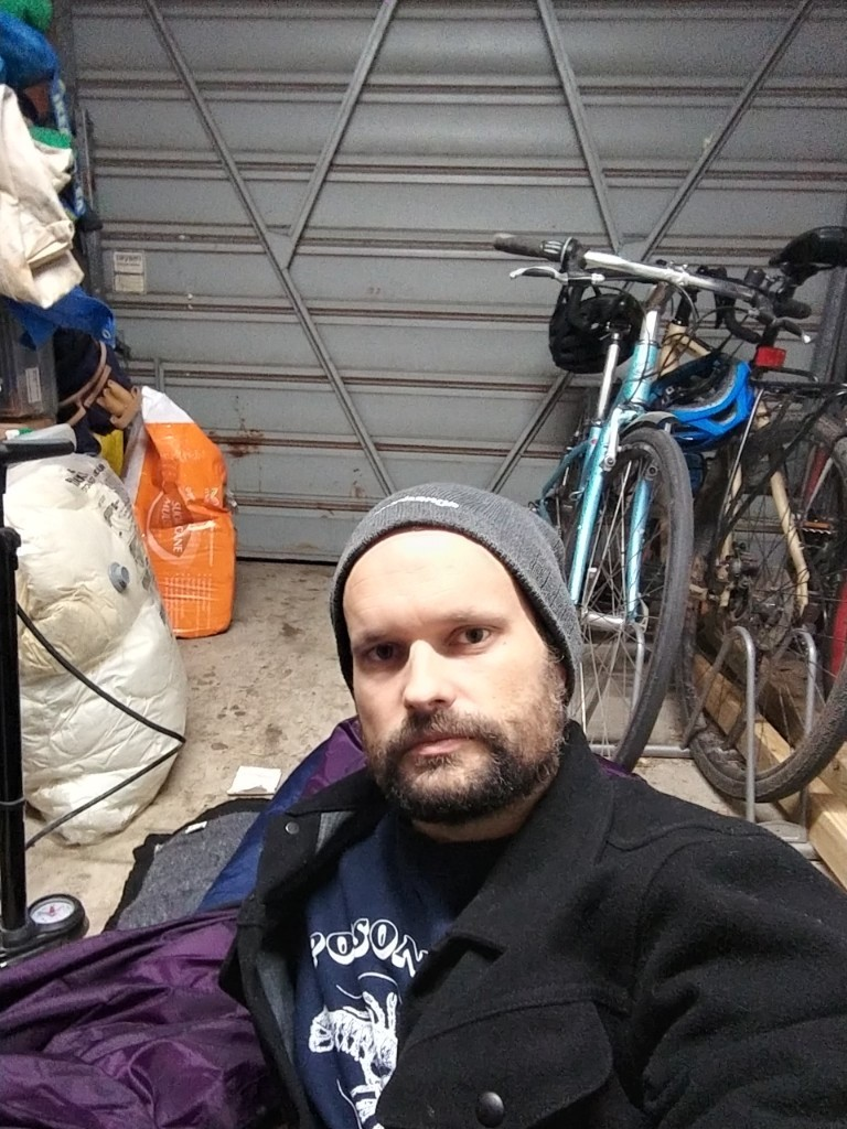 Ask Izzy Product Manger, Ben Shaw, camping out in his garage