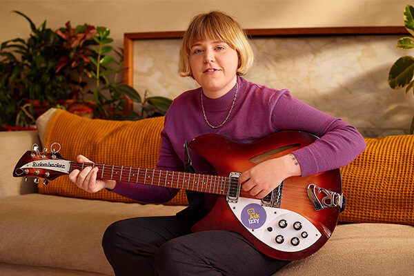 Nellie Jackson at home with her guitar